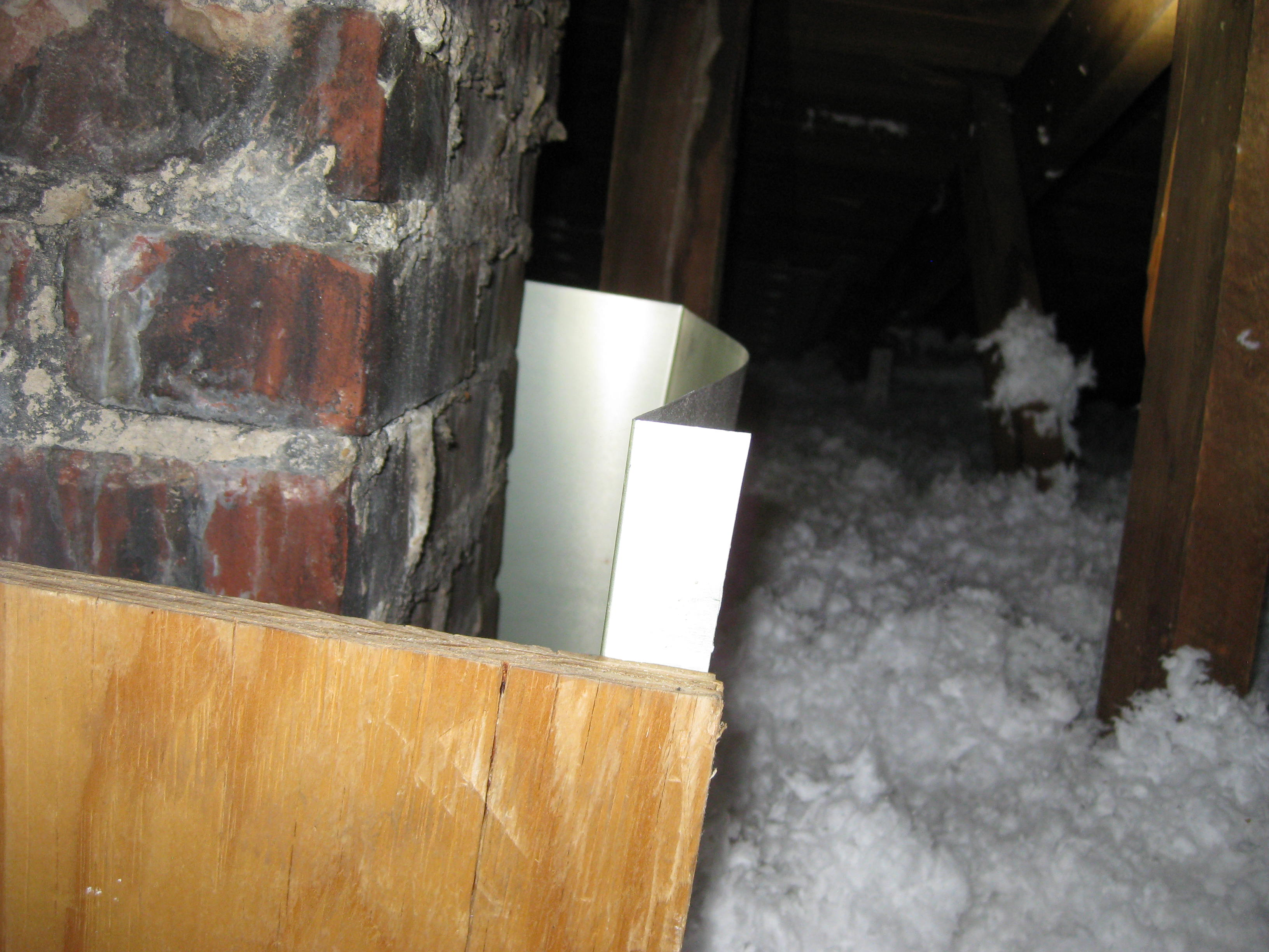 a dam around a chimney to keep the insulation from touching