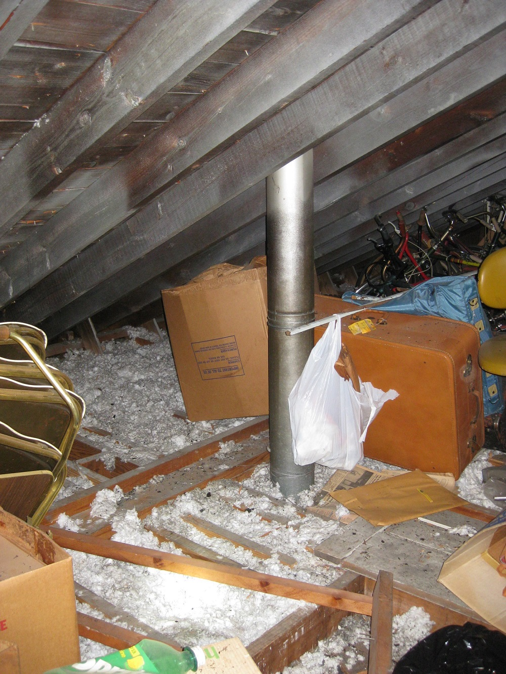 A hot furnace flue should have at least 2 inches of clearance all around it.