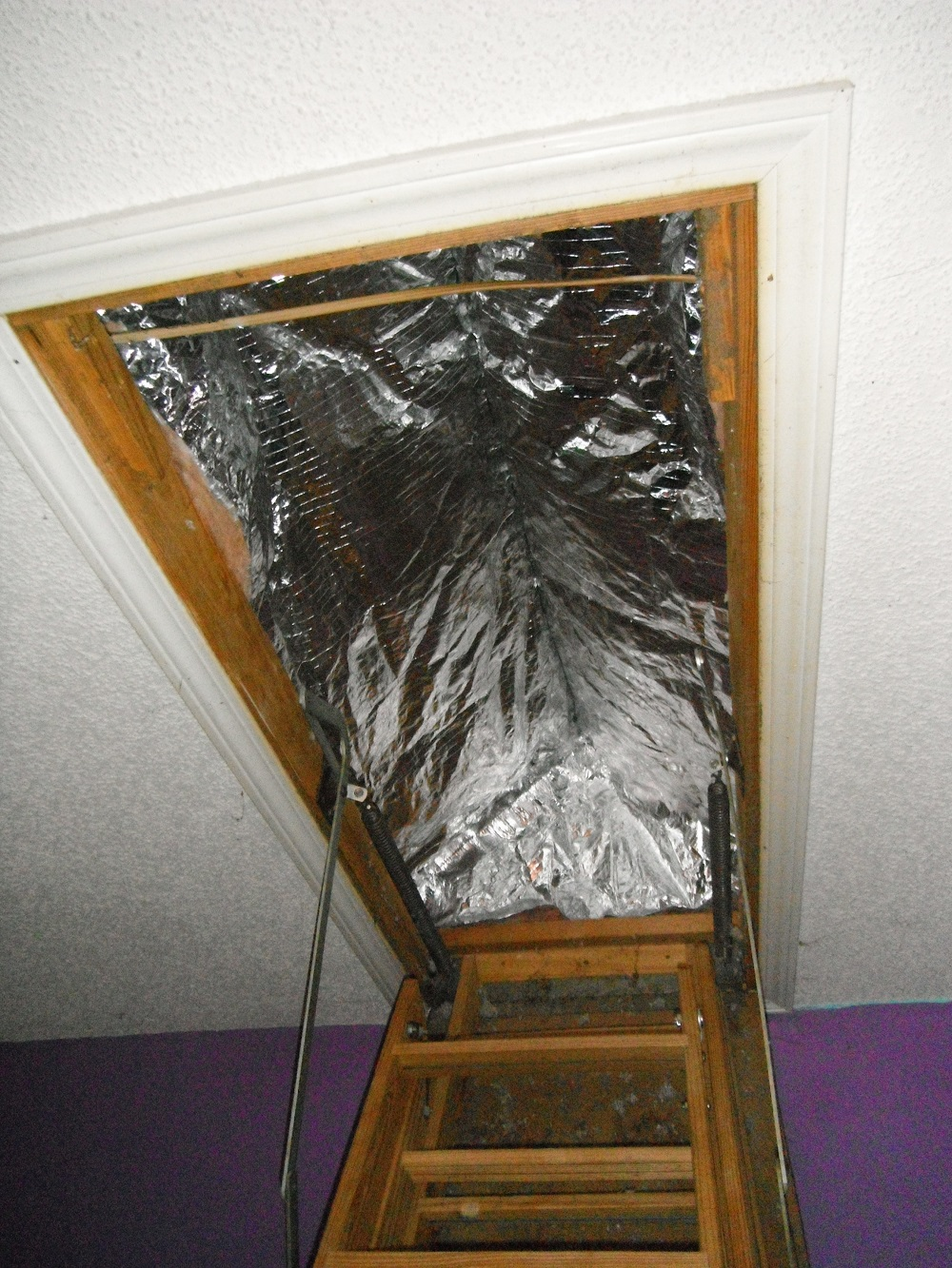 pull-down stairs insulated with a purchased insulating tent. Not much air sealing value.