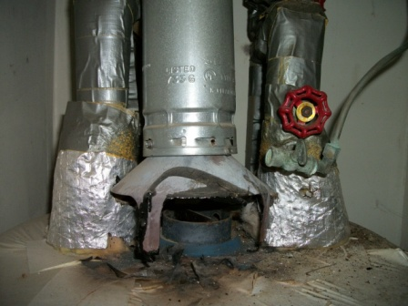 combustible materials too close to the water heater exhaust. Note the burned areas.